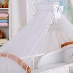 Красивый белый балдахин на детскую кроватку с бантом